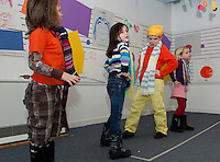 """Aydyn Berube, Sabrina Alan, Cameron Hayward and Didi Harding put colors into feelings during their performance of Dr. Seuss' """"My Many Colored Days"""" at Winni Playhouse Theater Camp Friday morning.  (Karen Bobotas/for the Laconia Daily Sun)"""
