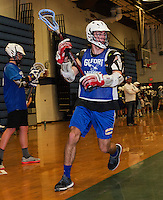 Kris Shepard works on drills with the Lacrosse team in the Gilford High School gym on Friday afternoon .  (Karen Bobotas/for the Laconia Daily Sun)