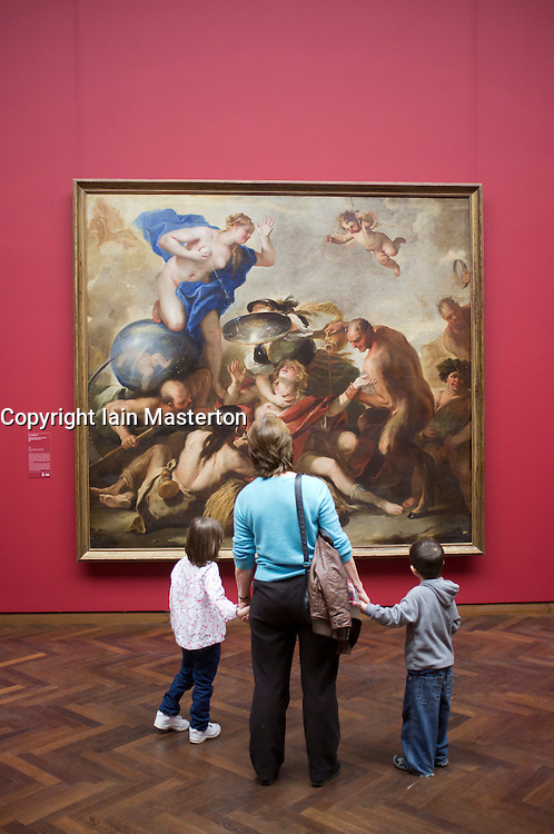 Visitors looking at painting Youth Tempted by the Vices by Luca Giordano at Stadel museum in Frankfurt Germany