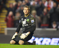 LIVERPOOL, ENGLAND - Saturday, January 19, 2013: Norwich City's goalkeeper Mark Bunn looks dejected after an own goal to hand Liverpool their fifth goal during the Premiership match at Anfield. (Pic by David Rawcliffe/Propaganda)