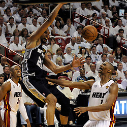 Jun 18, 2013; Miami, FL, USA; San Antonio Spurs power forward Tim Duncan (21) dunks against Miami Heat center Chris Bosh (1) during the second quarter of game six in the 2013 NBA Finals at American Airlines Arena.  Mandatory Credit: Derick E. Hingle-USA TODAY Sports