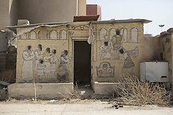 October 23, 2016 - Bartella, Nineveh, Iraq - A mural defaced by Islamic State militants is seen outside the Mart Shmony Church in Bartella, Iraq...Bartella, a mainly Christian town with a population of around 30,000 people before being taken by the Islamic State in August 2014, was captured two days ago by the Iraqi Army's Counter Terrorism force as part of the ongoing offensive to retake Mosul. Although ISIS militants were pushed back a large amount of improvised explosive devices are still being found in the town's buildings. (Credit Image: © Matt Cetti-Roberts/London News Pictures via ZUMA Wire)