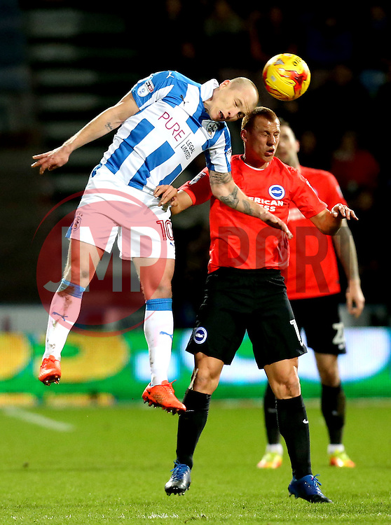 Aaron Mooy of Huddersfield Town challenges Steve Sidwell of Brighton & Hove Albion to a header - Mandatory by-line: Robbie Stephenson/JMP - 02/02/2017 - FOOTBALL - John Smith's Stadium - Huddersfield, England - Huddersfield Town v Brighton and Hove Albion - Sky Bet Championship