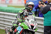 Leon Haslam (91) JG Speedfit Kawasaki returns to the pits after making it a double at the BSB Championship at the TT Circuit,  Assen, Netherlands on 2nd October 2016. Photo by Nigel Cole.