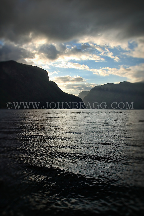 Scenic view of the sea and mountains with the sun and clouds on the Sognefjord in Norway