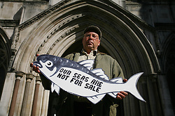 © Licensed to London News Pictures 01/05/2013.Fisherman Kirk Stribling from Suffolk was one of 10 fishermen, supported by Greenpeace, to arrive at the High Court in London to hear the start of a landmark legal case regarding who controls Britain's fishing quota. Large companies control 95% of the quota, in contrast to small scale fishermen who have access to 4% of fishing rights. Large companies are bringing the government to court over its decision to re-locate a small surplus of the fishing quota back to the small scale fishing, which Greenpeace supports as it is more sustainable..London, UK.Photo: Anna Branthwaite/LNP