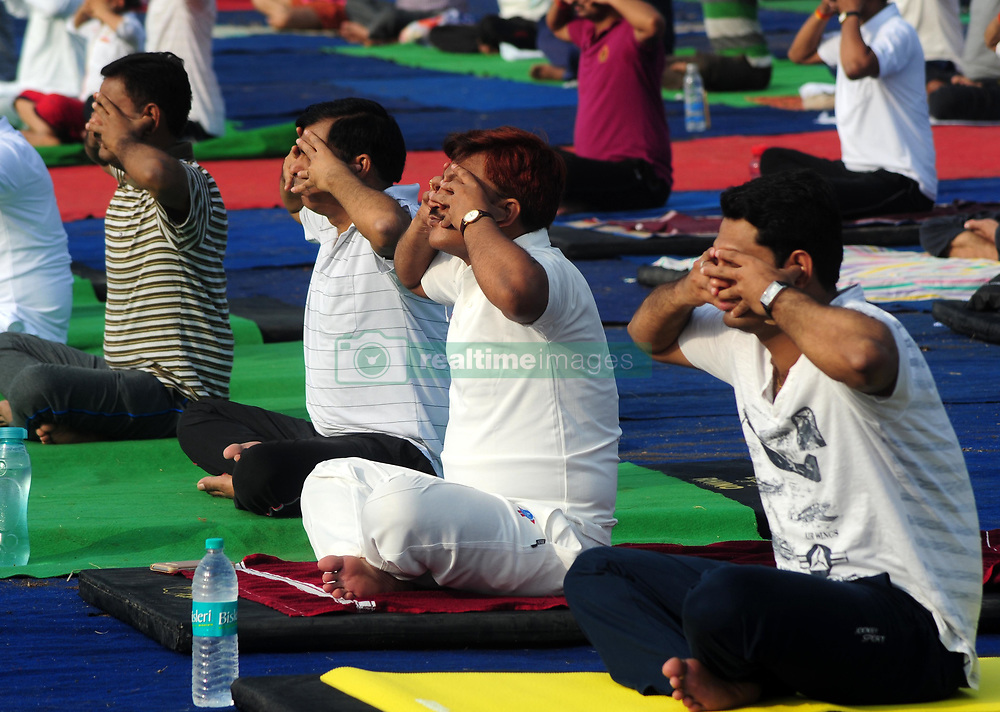 June 17, 2017 - Allahabad, Uttar Pradesh, India - People perform Yoga ahead of International Yoga day celebration at Parade Ground in Allahabad. International Day of Yoga, or commonly and unofficially referred to as Yoga Day, is celebrated annually on 21 June since its inception in 2015. An international day for yoga was declared unanimously by the United Nations General Assembly (UNGA) on 11 December 2014. Yoga is a physical, mental, and/or spiritual practice attributed mostly to India. The Indian Prime Minister Narendra Modi in his UN address suggested the date of 21 June, as it is the longest day of the year in the Northern Hemisphere and shares special significance in many parts of the world. (Credit Image: © Prabhat Kumar Verma/Pacific Press via ZUMA Wire)