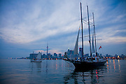 Boats in the harbor at Toronto, on Lake Ontario, Canada, at dusk.