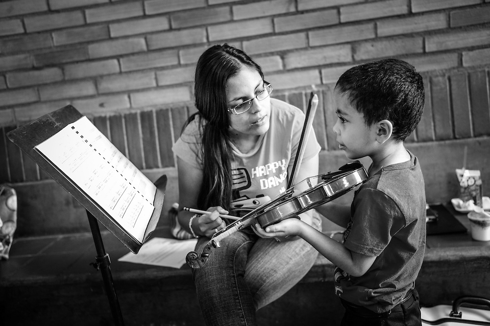 Students learn to play classical music at the Barquisimeto nucleo, of the El Sistema music program in Caracas, Venezuela. The Barquisimeto nucleo is where Maestro Abreu founded the El Sistema program, and where Gustavo Dudamel grew up.