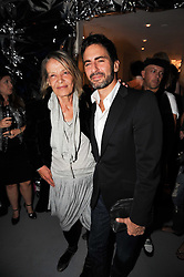 ANITA PALLENBERG and MARC JACOBS at a party to celebrate the launch of Bang a new male fragrance by Marc Jacobs held at the Fith Floor Restaurant, Harvey Nichols, Knightsbridge, London on 22nd July 2010.