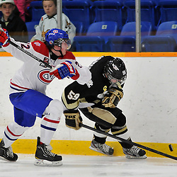 COBOURG, ON - Oct 19: Ontario Junior Hockey League game between Kingston Voyageurs and Trenton Golden Hawks. Taylor Brown #72 of the Kingston Voyageurs prepares to check Nick Marinac #59 of the Trenton Golden Hawks during first period game action..(Photo by Shawn Muir / OJHL Images)
