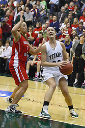 18 March 2011: Hope Schulte heads for the hoop defended by Bethany Morrison during an NCAA Womens basketball game between the Washington University Bears and the Illinois Wesleyan Titans at Shirk Center in Bloomington Illinois.