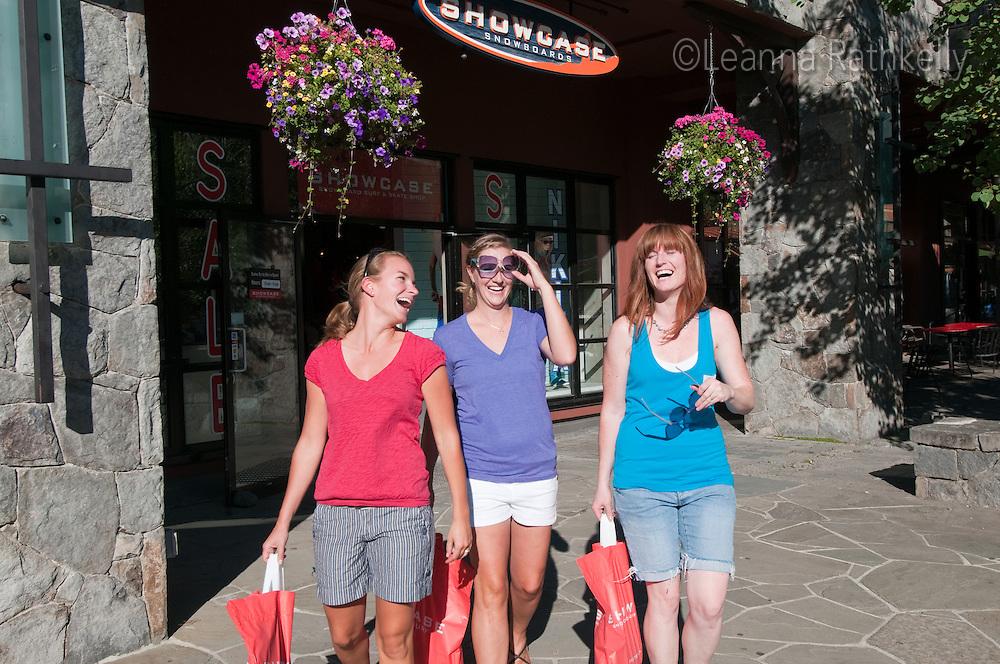 Women enjoy a days shopping in Whistler Village, outside the store, Showcase.
