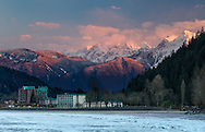 Harrison Hot Springs Resort and sunset on the Mount Cheam Range.  Photographed from Harrison Lake at Harrison Hot Springs, British Columbia, Canada
