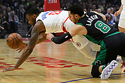 LA Clippers guard Sindarius Thornwell #0 dives past Boston Celtics guard Shane Larkin #8 for the ball in the first half. The Los Angeles Clippers played the Boston Celtics in a regular season NBA matchup in Los Angeles, CA 1/025/2018 (Photo by John McCoy, Los Angeles Daily News/SCNG)