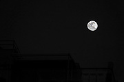 full moon on a dark black sky