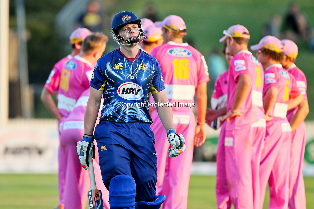 Otago Volt's Michael Bracewell walks off the ground after he is dismissed for 31 during the HRV Cup - Northern Knights v Otago Volts at Seddon Park, Hamilton on Friday 14 December 2012.  Photo: Bruce Lim / Photosport.co.nz