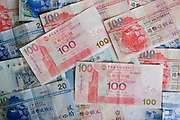 Hong Kong Dollar bills feature image of the Bank of China Building, Hong Kong, China