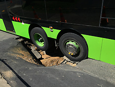 Wellington-Bus trapped by sink hole, Newlands