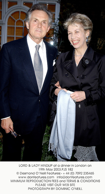 LORD & LADY HINDLIP at a dinner in London on 19th May 2003.PJS 182