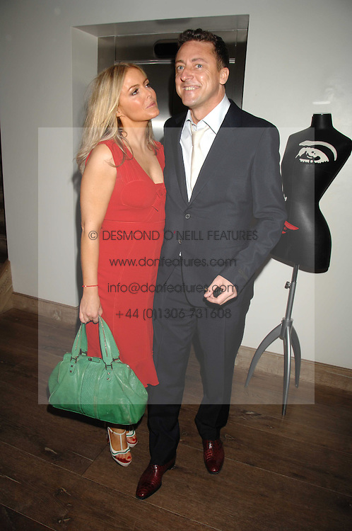PATSY KENSIT and JEREMY HEALY at a party to celebrate the launch of the Boodles Wonderland jewellery collection held at the Haymarket Hotel, 1 Suffolk Place, London on 9th June 2008.<br />