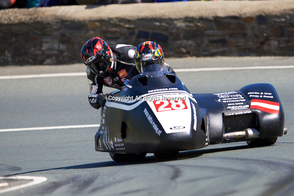 08.06.2015. Douglas, Isle of Man. 2015 Isle of Man TT Races. MichaelGrabmuler and Manfred Wechselberger in action during the TT Sidecar race.