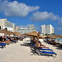 Beach Clubs at Playa Gaviota Azul in Cancun, Mexico<br /> All of the beaches from Cancun down through the Rivera Maya are public. You are free to swim and stretch out a towel where you want, even in the shadows of a hotel. Of course, the amenities are reserved for their guests. If you want the services &ndash; loungers, umbrellas, cocktail service, restrooms &ndash; at a very reasonable cost, consider a day pass at a beach club. The most popular is the Mandala Beach Club behind the Plaza Forum By The Sea. The price of admission includes a party atmosphere around the pool accompanied by DJ music.