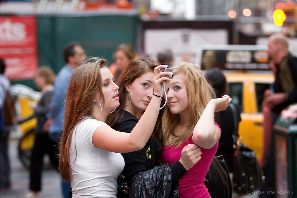Teens take a selfie before camera phones were popular, Times Square, New York City, August 15, 2006.