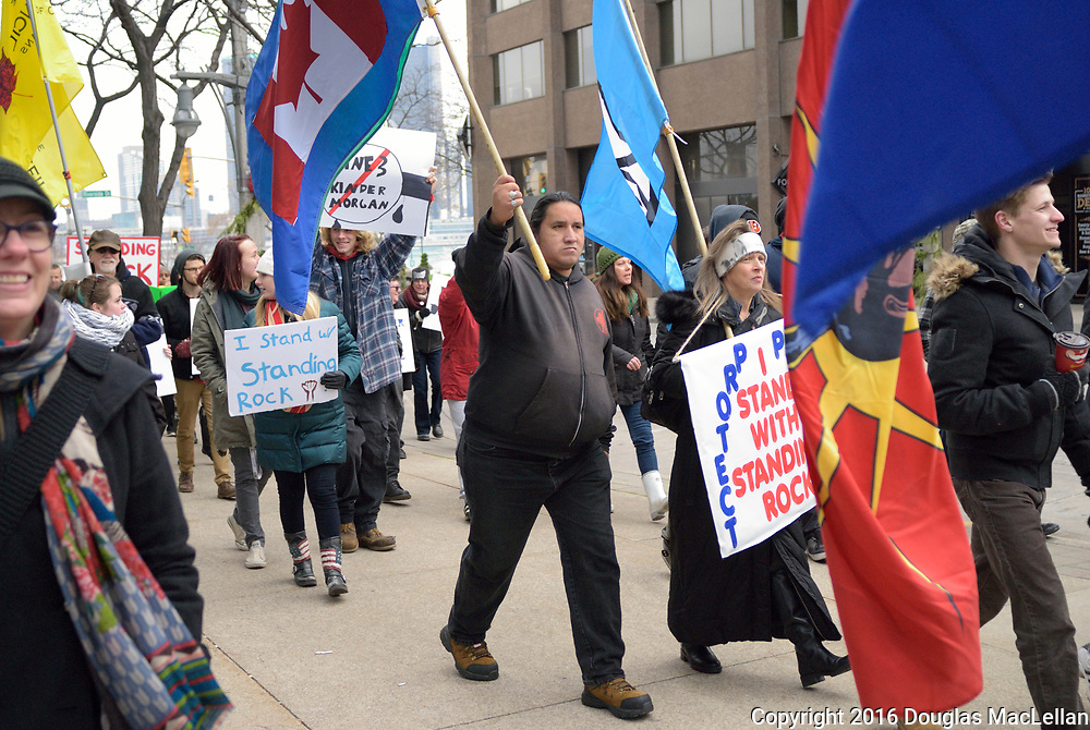Standing Rock march and demonstration starts with a smudging ceremony and speeches at Dieppe Park by the waterfront. A march to RBC branch on Ouellette and Chatham where more speeches are made. Finally a walk back to Dieppe Park for yet more speeches, information gathering for an email list and chili. Note after this demonstration it is reported that the pipline will not go through Sioux land.