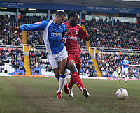 Photo: Mark Stephenson.<br />Birmingham City v Reading. The FA Cup. 27/01/2007.<br />Reading's Andre Bikey (R) on the ball is tackled by Birmingham's Dj Campball