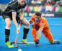 The Netherlands Glenn Schuurman tackles Chris Ruehr of Germany. The Netherlands v Germany - Final Unibet EuroHockey Championships, Lee Valley Hockey & Tennis Centre, London, UK on 29 August 2015. Photo: Simon Parker