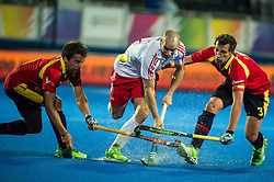 England's Nick Catlin is tackled by Sergi Enrique and Marc Salles of Spain. England v Spain - Unibet EuroHockey Championships, Lee Valley Hockey & Tennis Centre, London, UK on 25 August 2015. Photo: Simon Parker
