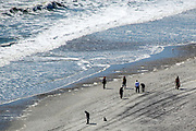 People strolling the beach in Atlantic City. The city is in trouble after three casinos have closed in rapid succession, the latest being The Revel Resort.