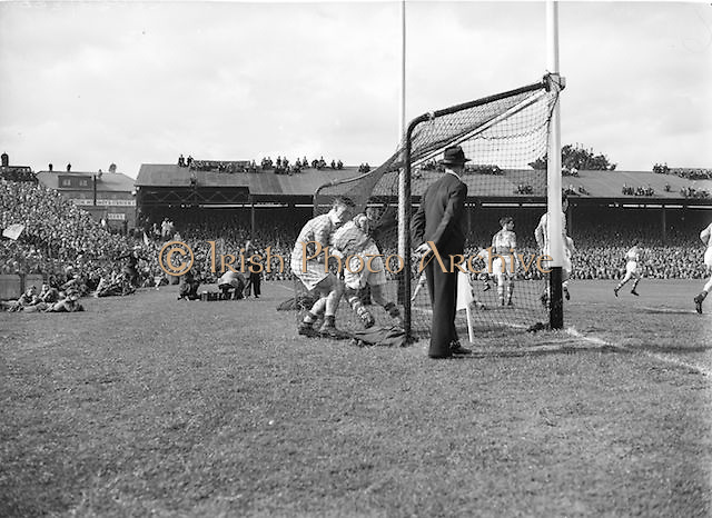 Players tackle in the goal net during the All Ireland Minor Gaelic Football Final Dublin v Tipperary in Croke Park on 25th September 1955. Dublin 4-04, Tipperary 2-07.
