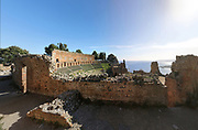 Greek Theatre, built 3rd century BC, with its brick cavea wall, in Taormina, Messina, Sicily, Italy. Although originally and typically Greek, used for theatre and music performances, the theatre was remodelled in the 2nd century AD by the Romans and used for games and gladiatorial contests. Picture by Manuel Cohen