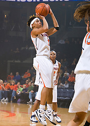Virginia guard Britnee Millner (12) shoots a jumper against High Point.  The #15 ranked Virginia Cavaliers defeated the High Point Panthers 78-48 in NCAA Women's Division 1 Basketball at the John Paul Jones Arena on the Grounds of the University of Virginia in Charlottesville, VA on November 14, 2008.