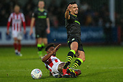 Forest Green Rovers Liam Shephard(2) is tackled by Cheltenham Town's Sean Long(2) during the EFL Sky Bet League 2 match between Cheltenham Town and Forest Green Rovers at Jonny Rocks Stadium, Cheltenham, England on 2 November 2019.