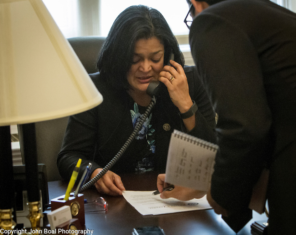 Representative Pramila Jayapal (D-WA, 7) does a phone interview with KOMO Radio, a local Seattle radio station, as Communications Director, Omer Farooque points out relevant notes, on Tuesday, January 31, 2017.  John Boal photo/for The Stranger