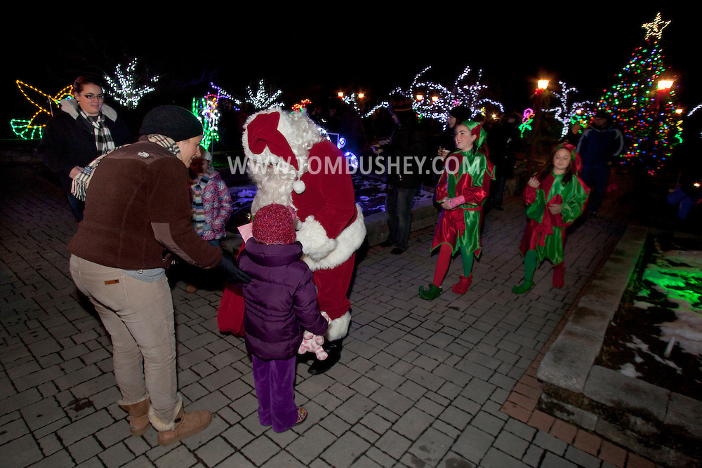 Hamptonburgh, New York - People watch the 44th annual tree lighting ceremony and Holiday Lights in Bloom display at the Orange County Arboretum at Thomas Bull Memorial Park on Nov. 29, 2012.