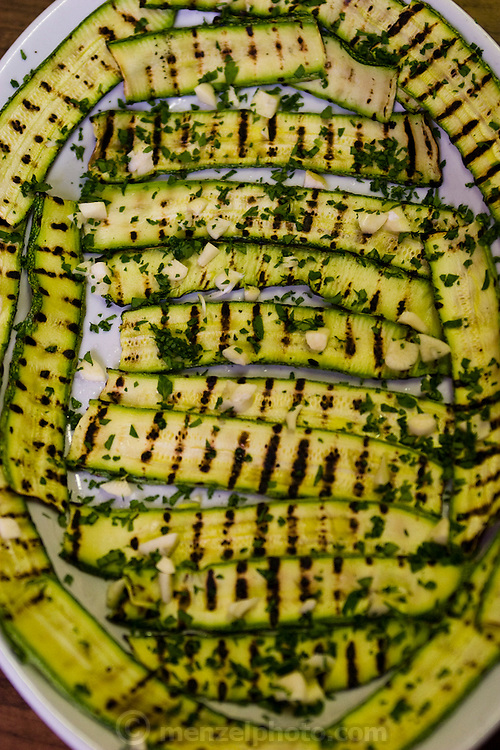 A plate of zucchini prepared with herbs for lunch at the San Marcello al Corso Church in Rome, Italy, near the Spanish Steps, where monk brother priest Riccardo Casagrande is in charge of the kitchen, garden, and wine cellar for the brotherhood. (Riccardo Casagrande is featured in the book What I Eat: Around the World in 80 Diets.)