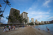 """Sunset at Waikiki Beach. The historic Royal Hawaiian Hotel is also known as the """"Pink Lady""""."""