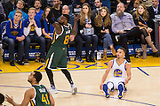 Golden State Warriors guard Stephen Curry (30) sits on the court after missing a three pointer against the Utah Jazz at Oracle Arena in Oakland, Calif., on December 20, 2016. (Stan Olszewski/Special to S.F. Examiner)