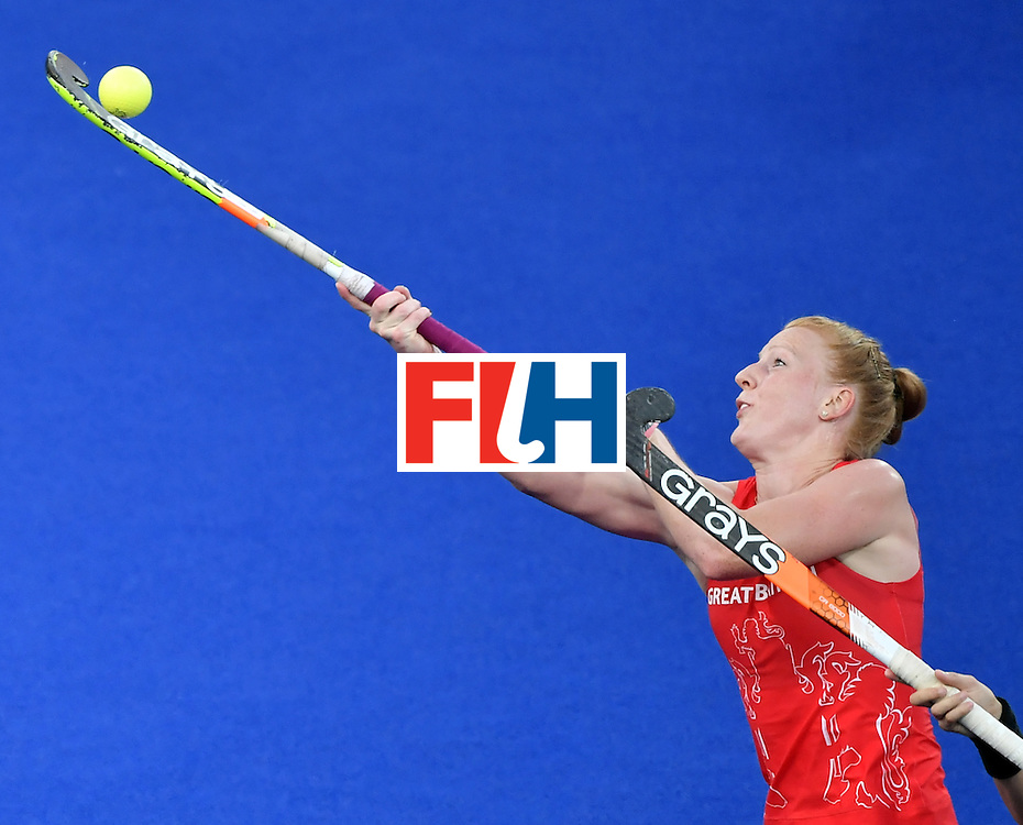 TOPSHOT - Britain's Nicola White hits the ball during the women's Gold medal hockey Netherlands vs Britain match of the Rio 2016 Olympics Games at the Olympic Hockey Centre in Rio de Janeiro on August 19, 2016. / AFP / Pascal GUYOT        (Photo credit should read PASCAL GUYOT/AFP/Getty Images)