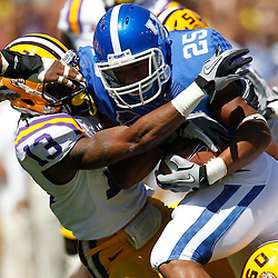 October 1, 2011; Baton Rouge, LA, USA;  Kentucky Wildcats running back Jonathan George (25) is tackled by LSU Tigers cornerback Ron Brooks (13)  during the first half at Tiger Stadium.  Mandatory Credit: Derick E. Hingle-US PRESSWIRE / © Derick E. Hingle 2011