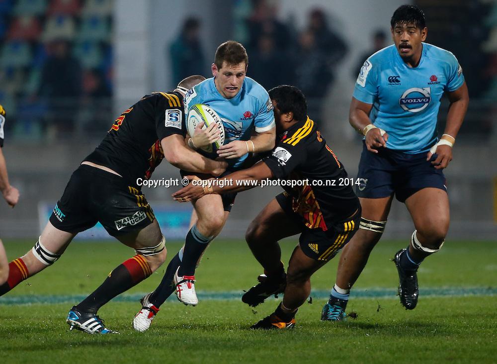 Waratahs Bernard Foley breaks a tackle. Super Rugby, Chiefs v Waratahs, Yarrow Stadium, New Plymouth, New Zealand. Saturday, 31 May, 2014. Photo: John Cowpland / photosport.co.nz