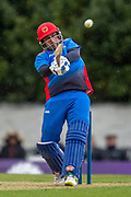 Mohammad Asghar of Afghanistan plays a shot during the One Day International match between Scotland and Afghanistan at The Grange Cricket Club, Edinburgh, Scotland on 10 May 2019.