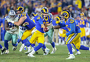 Jan 12, 2019; Los Angeles, CA, USA;  Los Angeles Rams quarterback Jerad Goff (16) hands off the ball to running back C.J. Anderson (35) against the Dallas Cowboys during an NFL divisional playoff game at the Los Angeles Coliseum. The Rams beat the Cowboys 30-22. (Kim Hukari/Image of Sport)