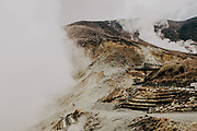 Duotone image of sulfur Mining activity in a mountainside photographed in Japan