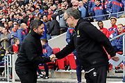 Bristol City manager Lee Johnson shakes hands with Leeds United Manager Marcelo Bielsa before the EFL Sky Bet Championship match between Bristol City and Leeds United at Ashton Gate, Bristol, England on 9 March 2019.