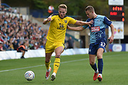 Oxford United defender defender Cameron Norman (2) sprints forward with the ball  under pressure from Wycombe Wanderers midfielder (on loan from Shrewsbury Town) Bryn Morris (17) during the EFL Sky Bet League 1 match between Wycombe Wanderers and Oxford United at Adams Park, High Wycombe, England on 15 September 2018.
